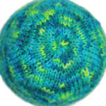Basic knit beanie made with Simply Soft Paints Peacock variegated yarn, pattern designed by PurlsAndPixels