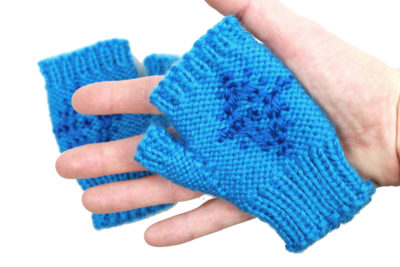 Toddler size snowflake fingerless mittens inspired by Anna from Frozen, designed by PurlsAndPixels