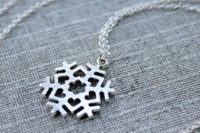 Silver snowflake love necklace, minimalist jewelry design by Liz @PurlsAndPixels