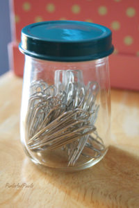 An up-cycled baby food jar is a great place to keep paperclips, from Liz @PurlsAndPixels